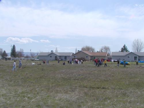 Higs school students picking up trash hin the big field between 3rd St and Punkin Center.