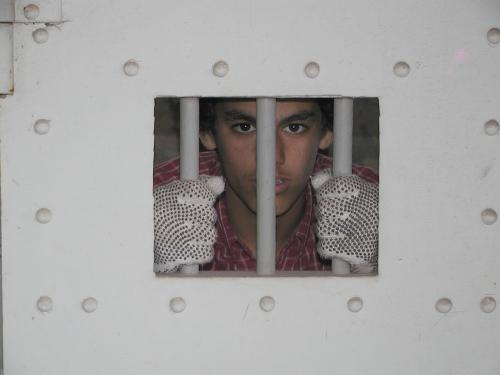 A cleanup student, behind bars inside the jail